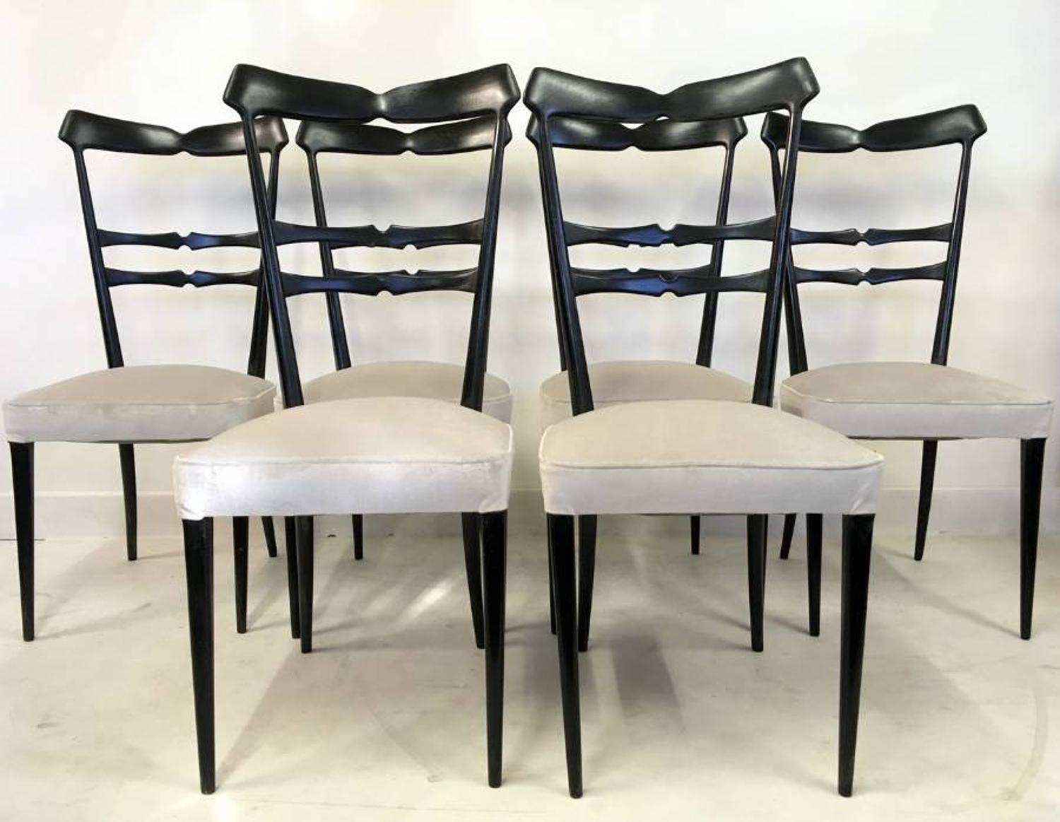 A set of six Italian ebonised dining chairs