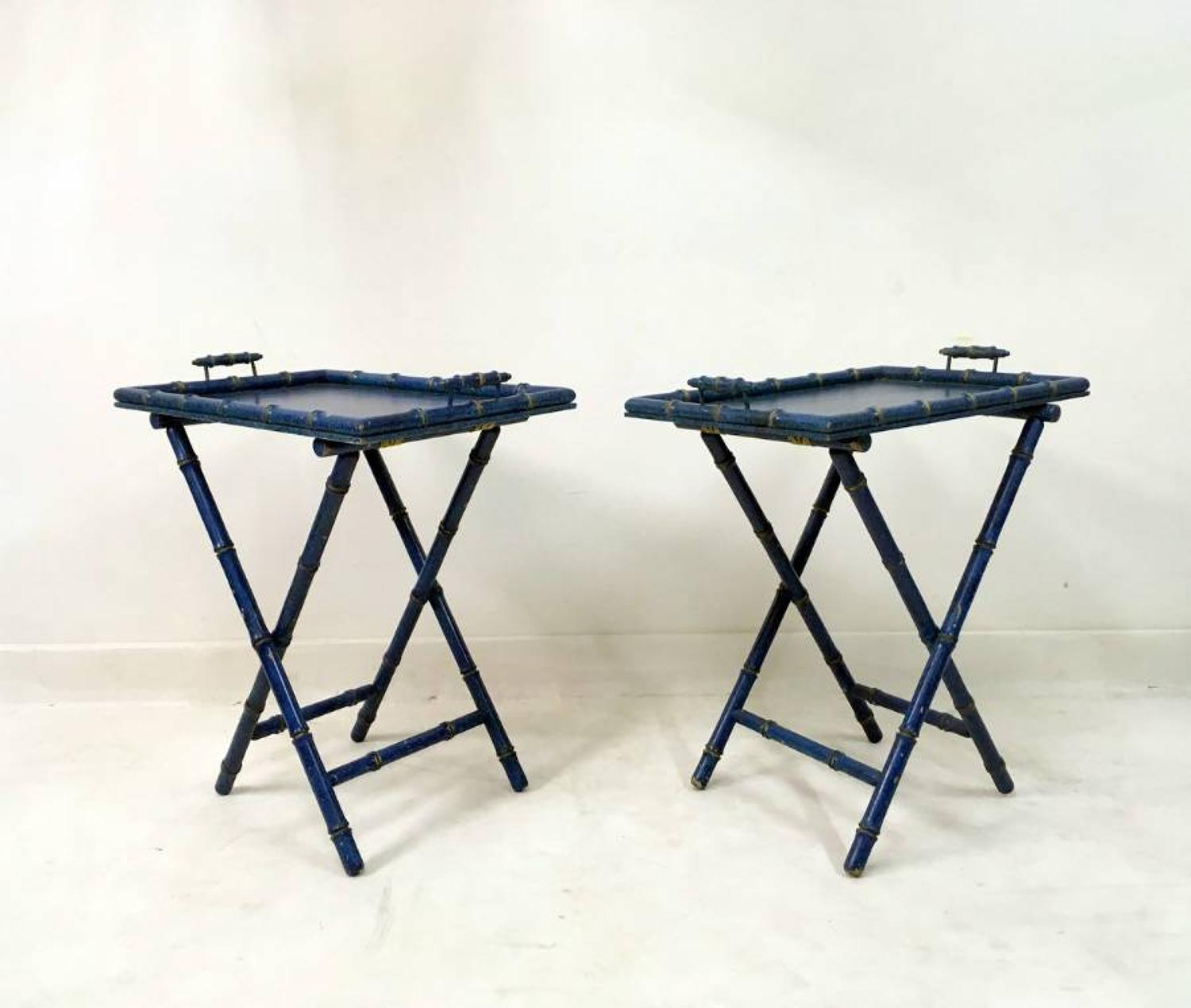 A pair of blue faux bamboo butler`s tray tables