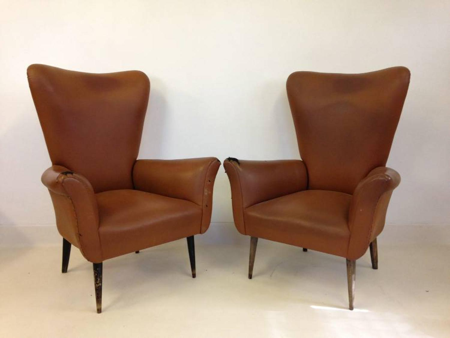 A pair of Italian wing armchairs