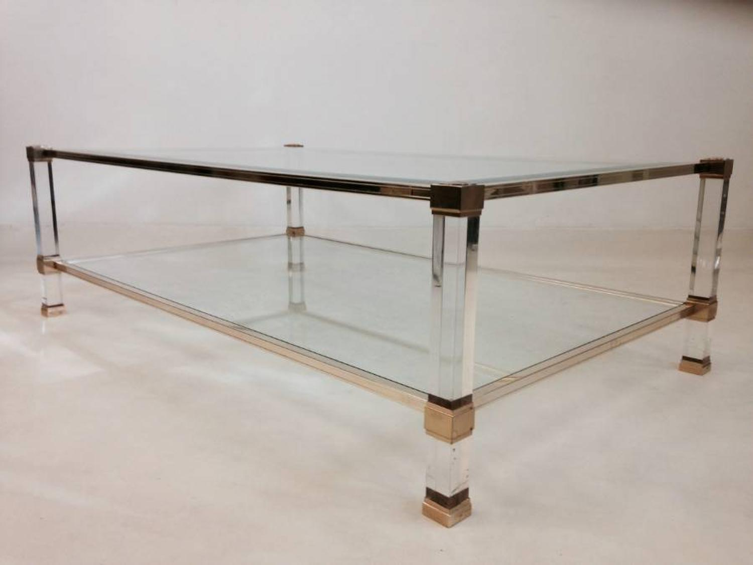 Lucite and brass coffee table by Pierre Vandel