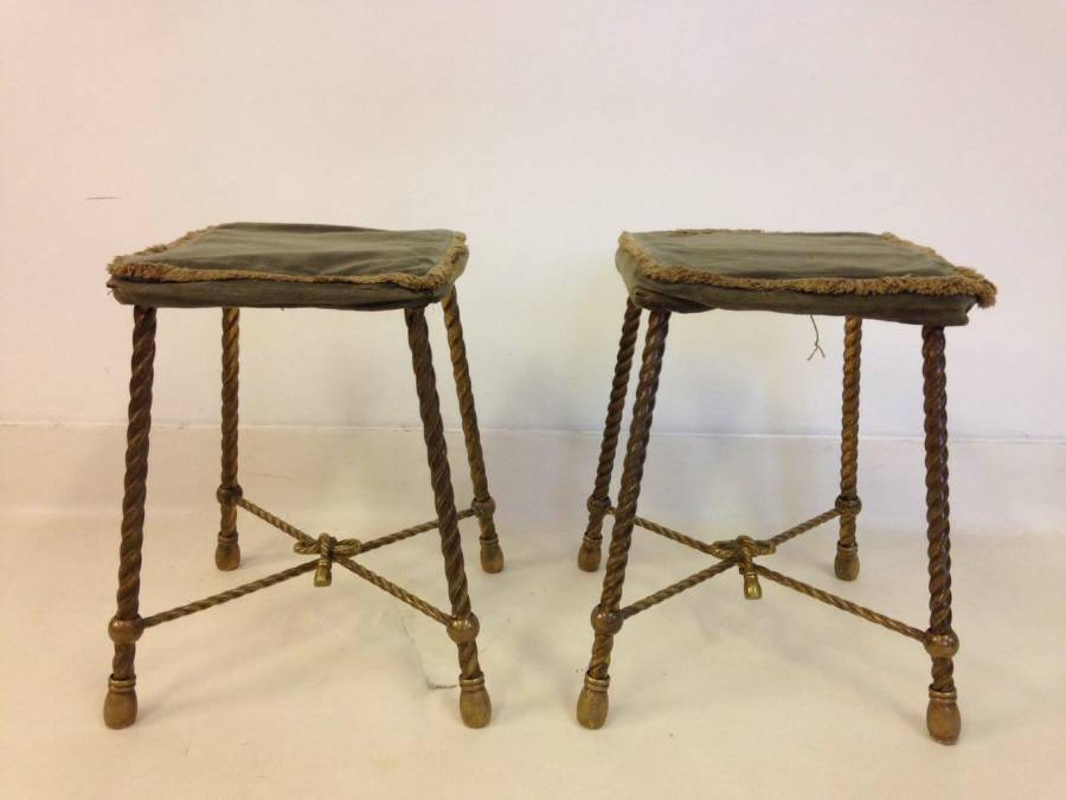 A pair of brass rope twist stools