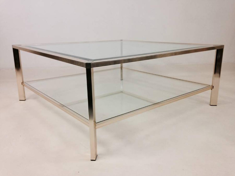 Two tier brass coffee table by Pierre Vandel
