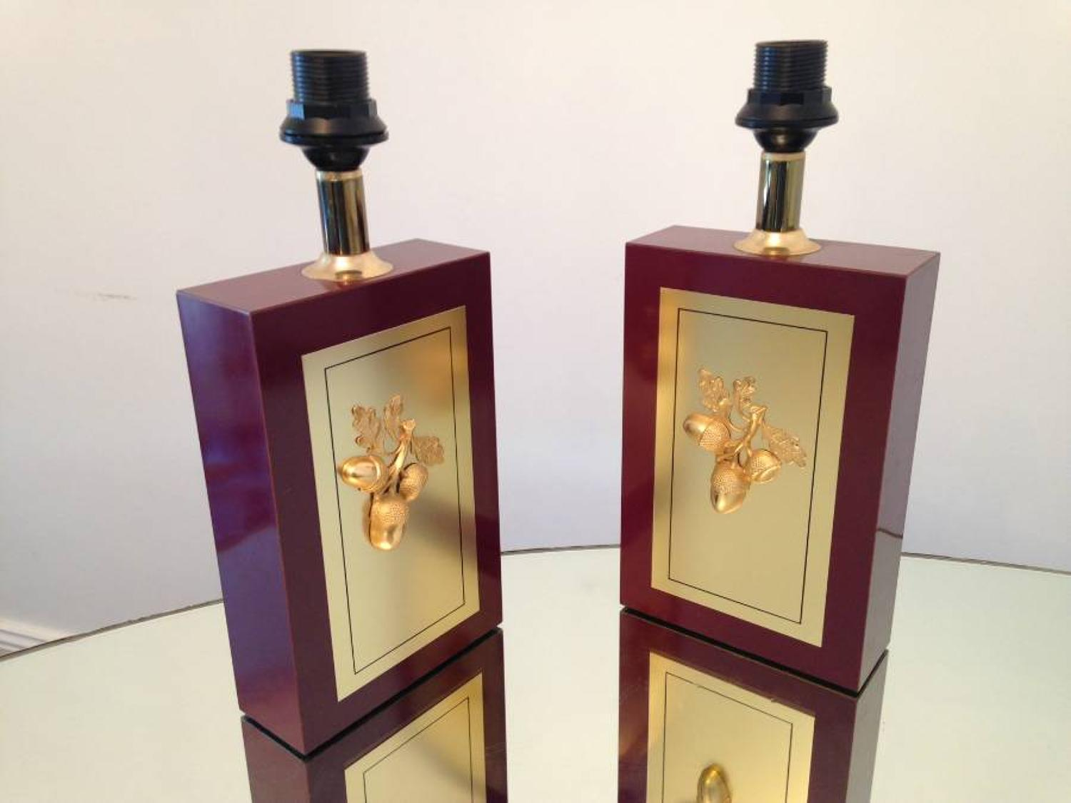 A pair of table lamps with brass acorn decoration