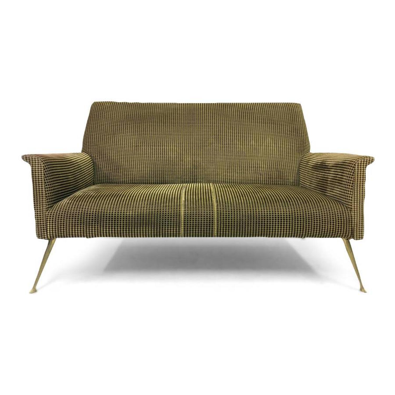 A 1960s Italian sofa on brass legs