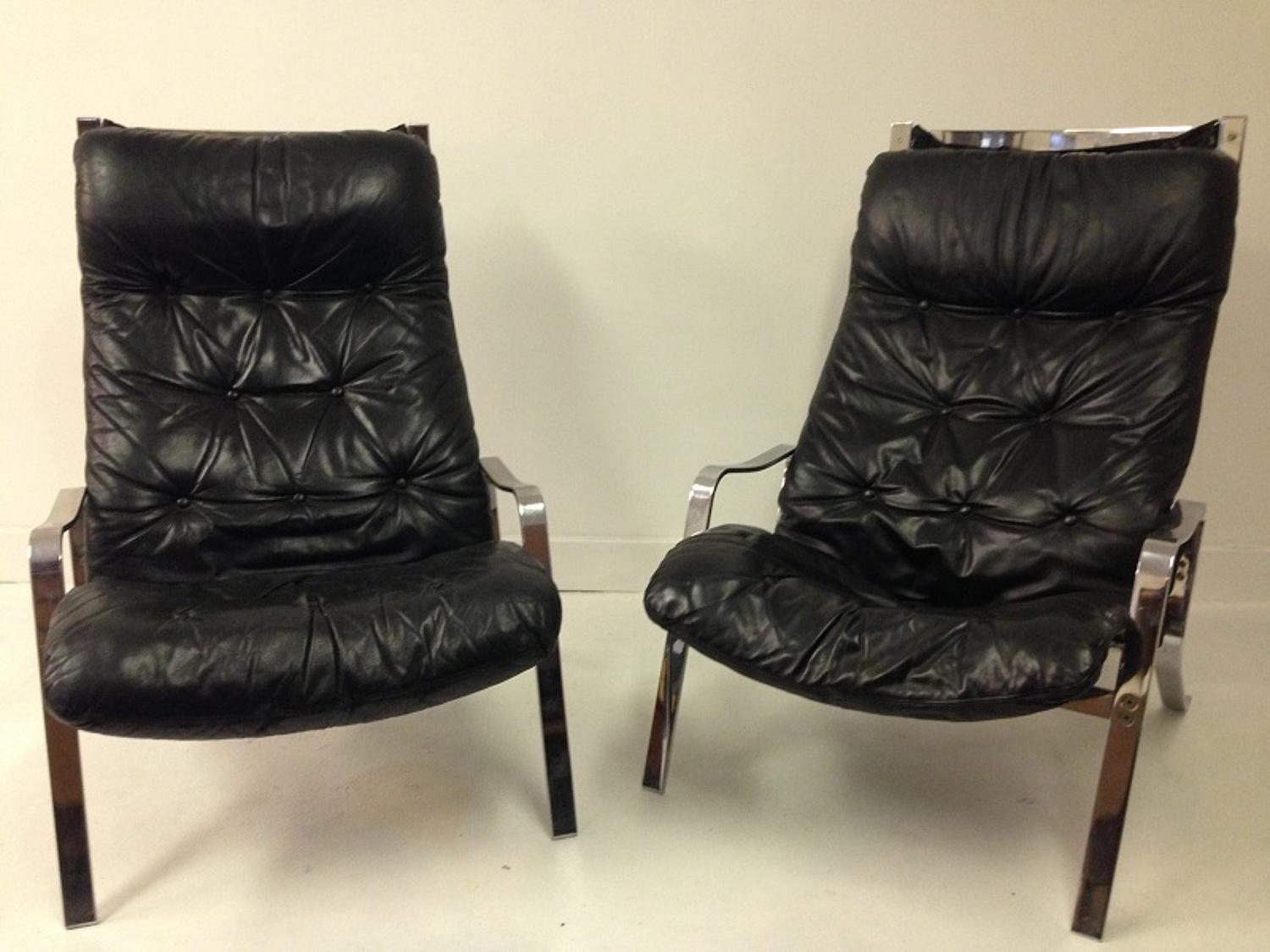 A pair of 1970s chrome and leather loungers