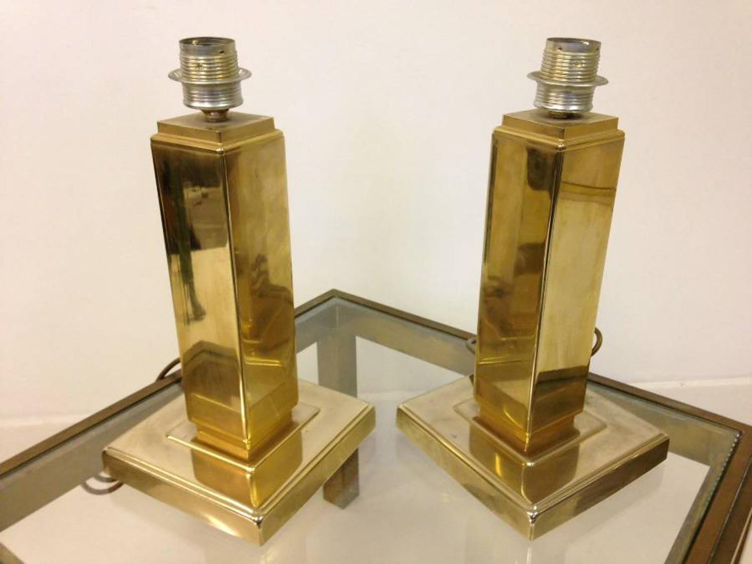 A pair of French gilt brass lamps
