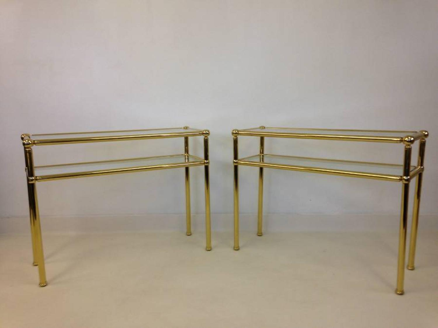 A pair of gilt brass console tables