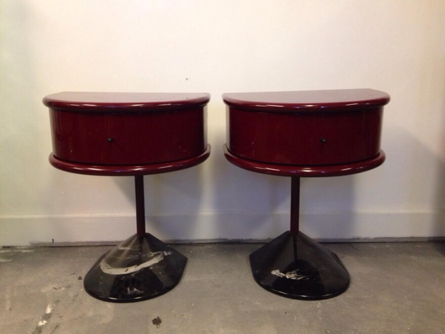A pair of red lacquered bedside tables