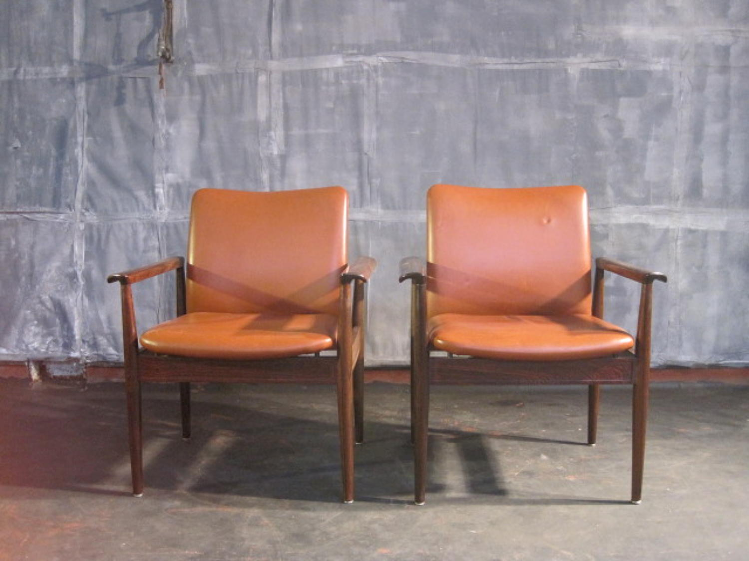 Rosewood and leather Diplomat chairs by Finn Juhl