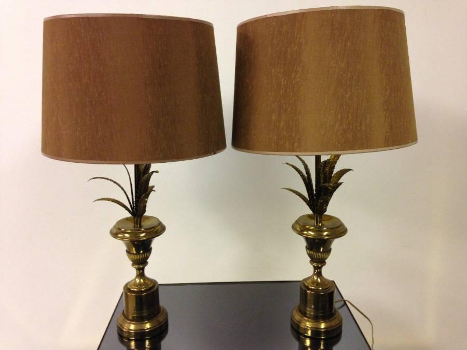 A pair of brass pineapple frond lamps