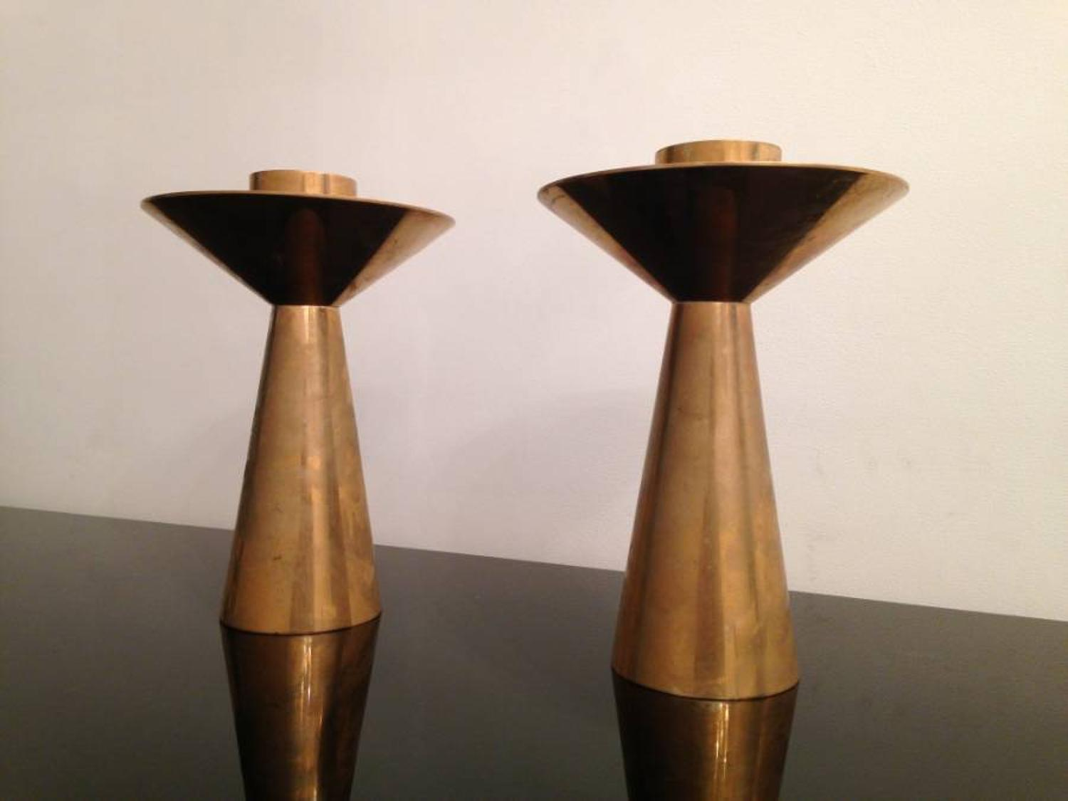 A pair of brass candle holders
