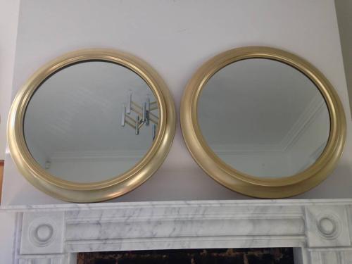 A pair of Italian gilt brass mirrors