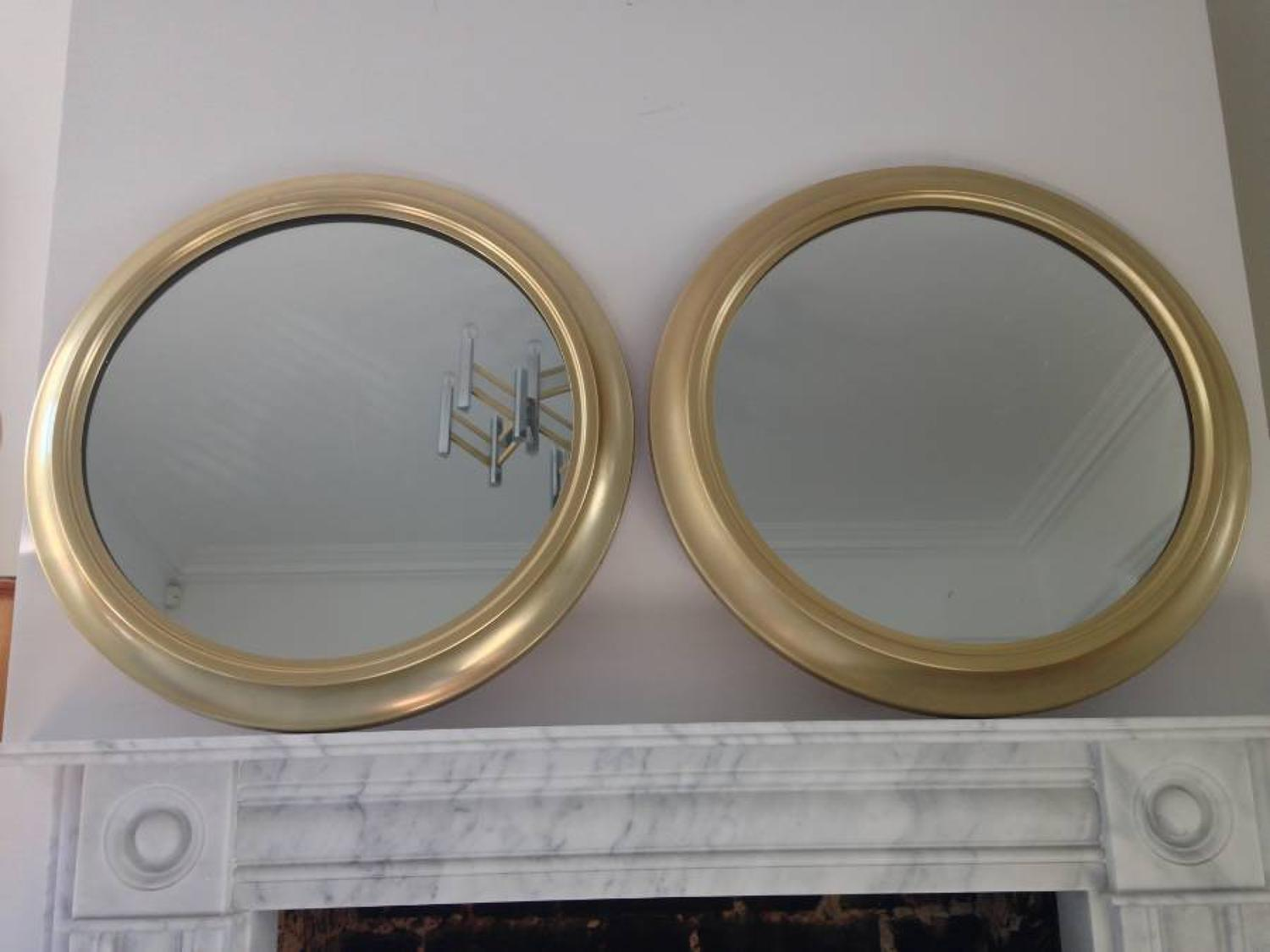 A pair of Italian gilt brass mirrors