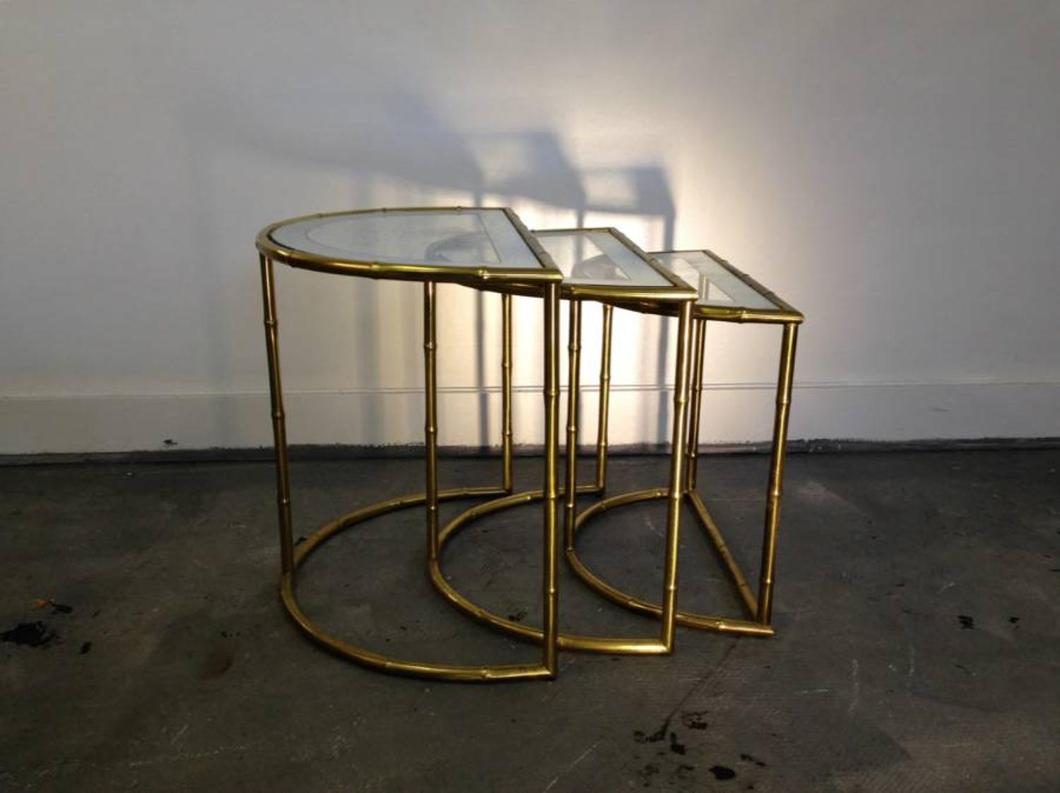 A pair of brass bamboo nest of tables