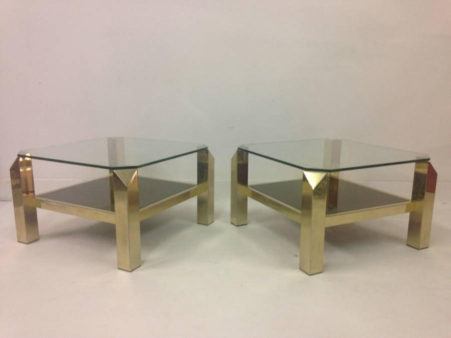A pair of gold plated side tables