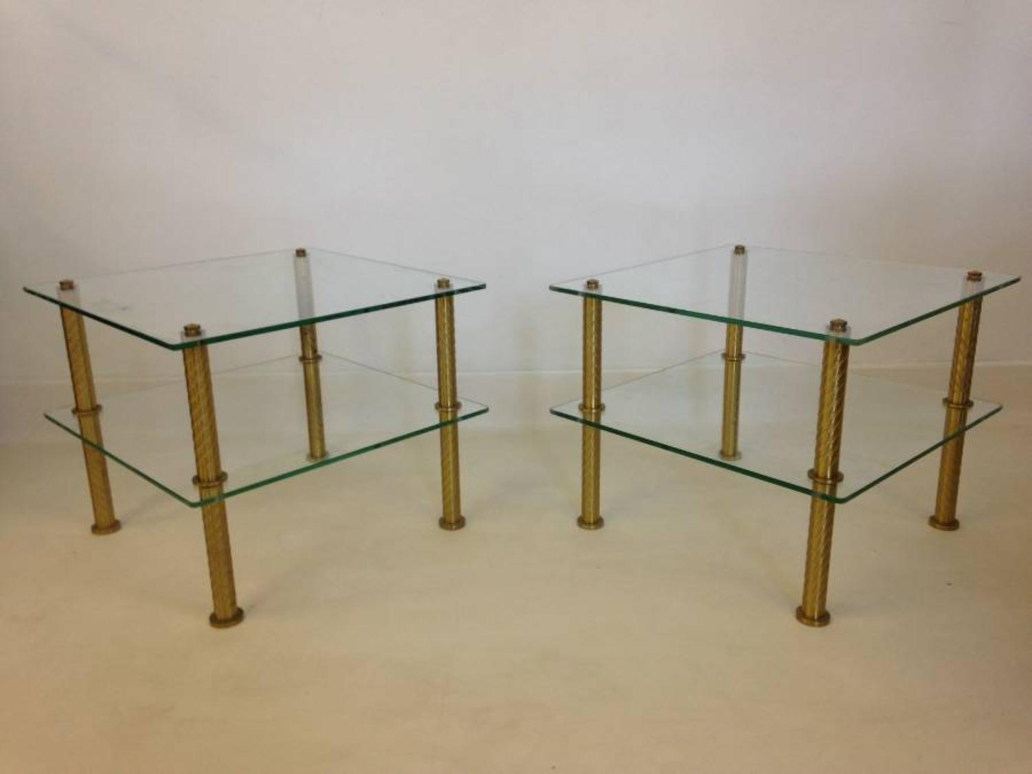 A pair of French brass and glass side tables