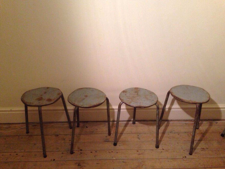 Vintage three legged metal stacking stools