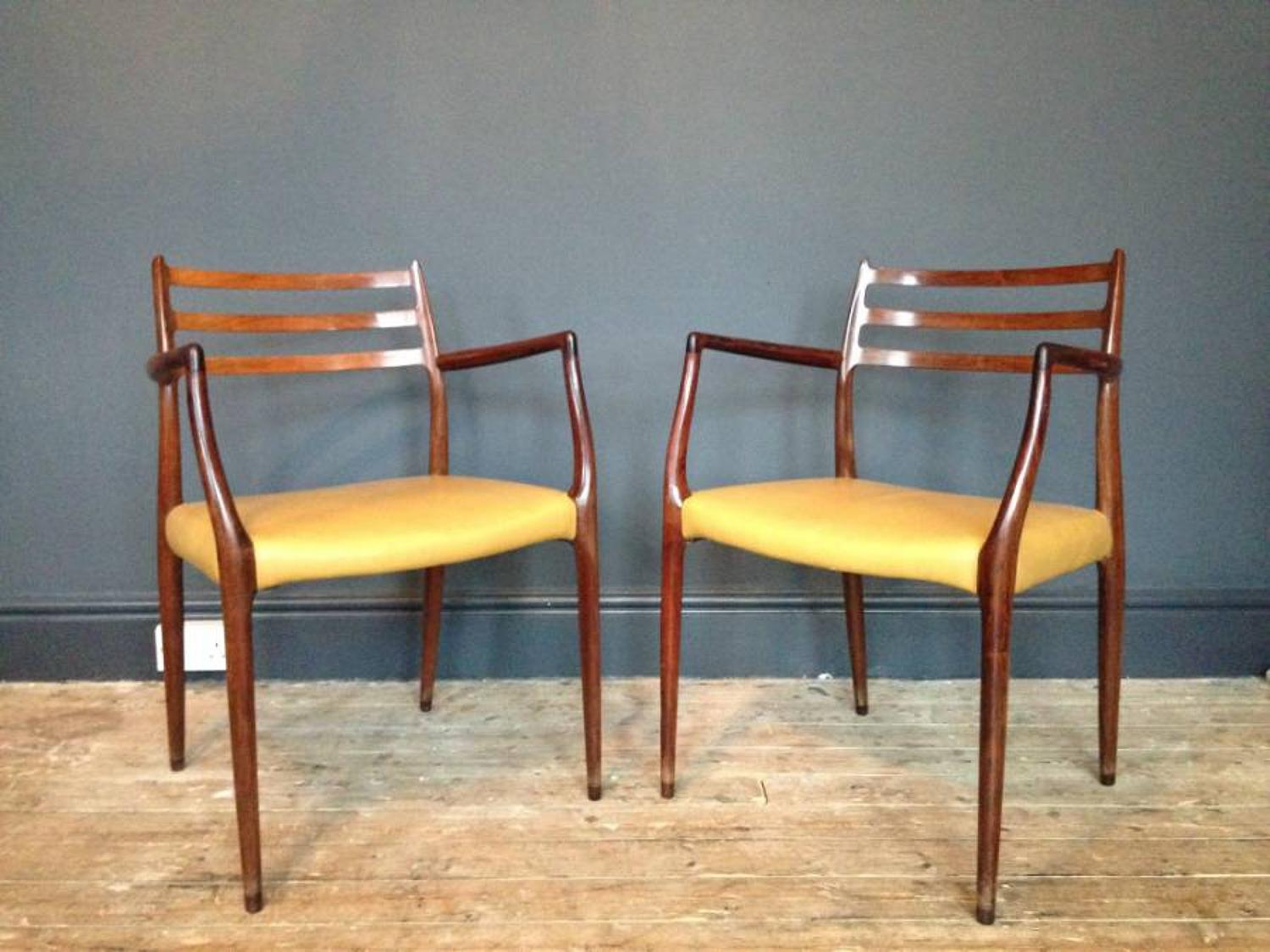 A pair of rosewood armchairs by Niels Moller