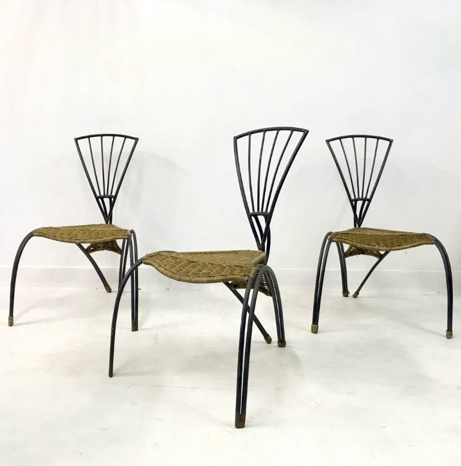 A set of wrought iron and rattan chairs