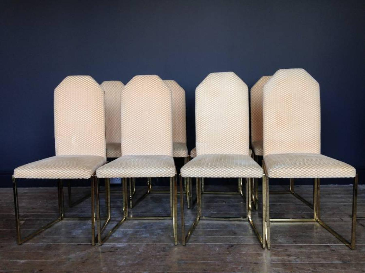A set of eight gilt metal dining chairs