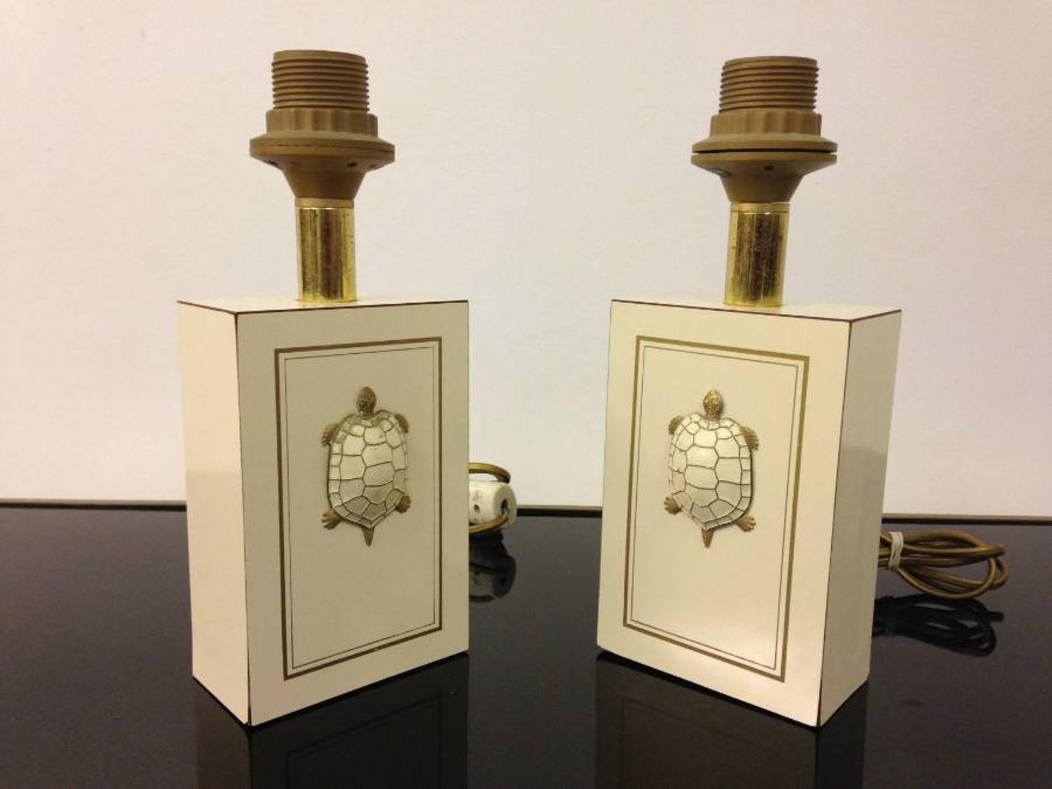 A pair of French brass turtle lamps