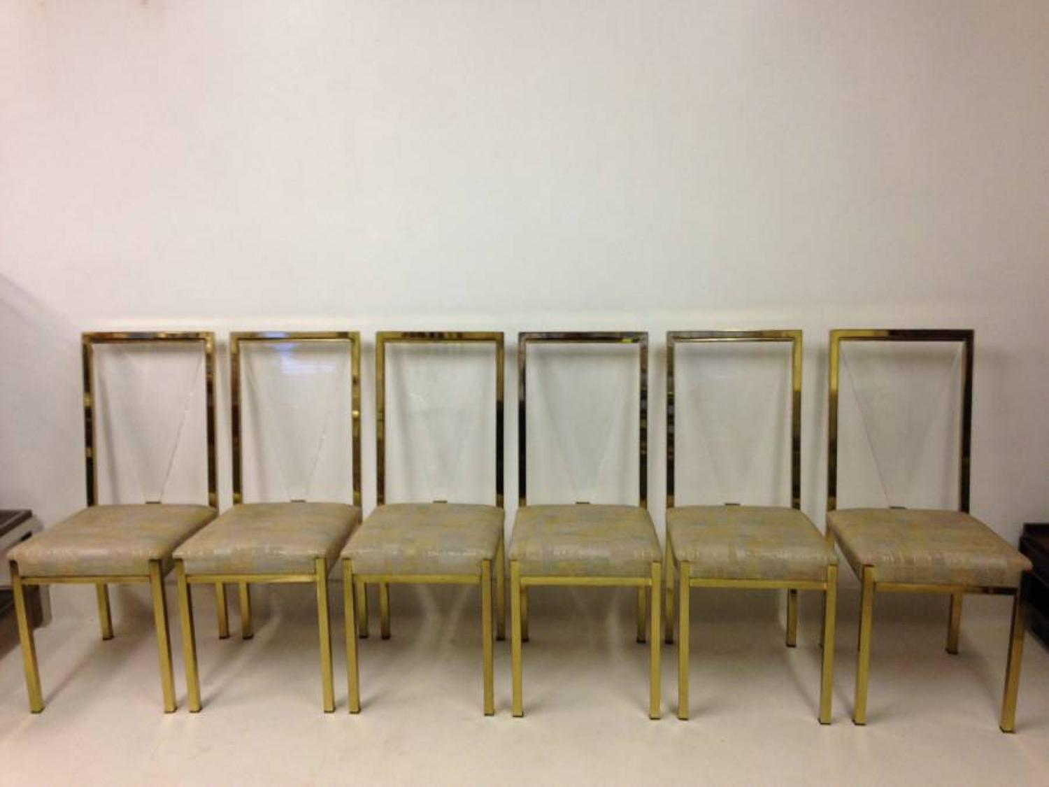 A set of lucite and gold lacquered metal chairs