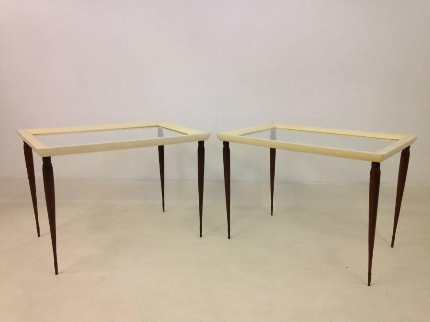 A pair of goatskin and hardwood side tables