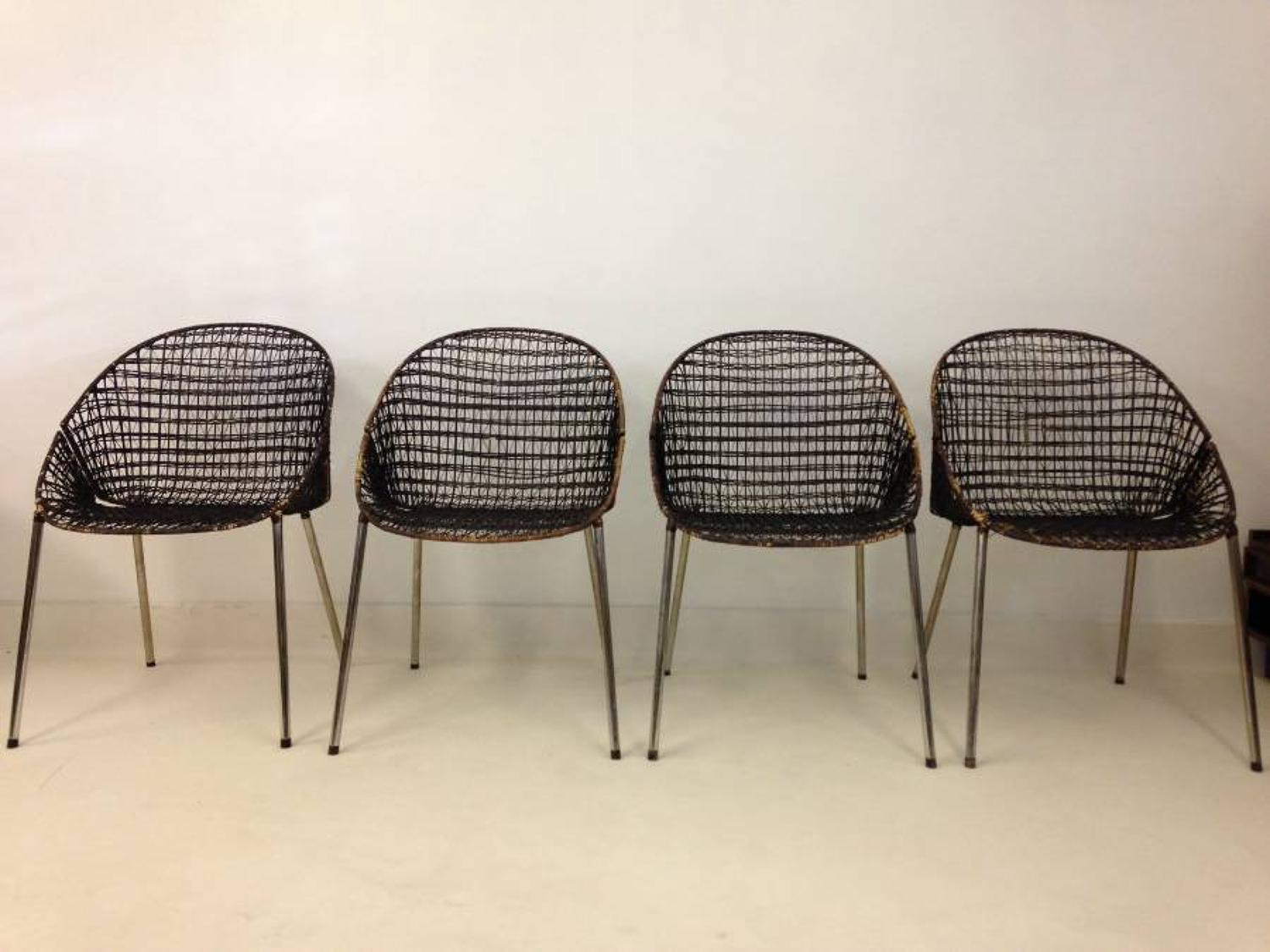 A set of four rattan and chrome dining chairs