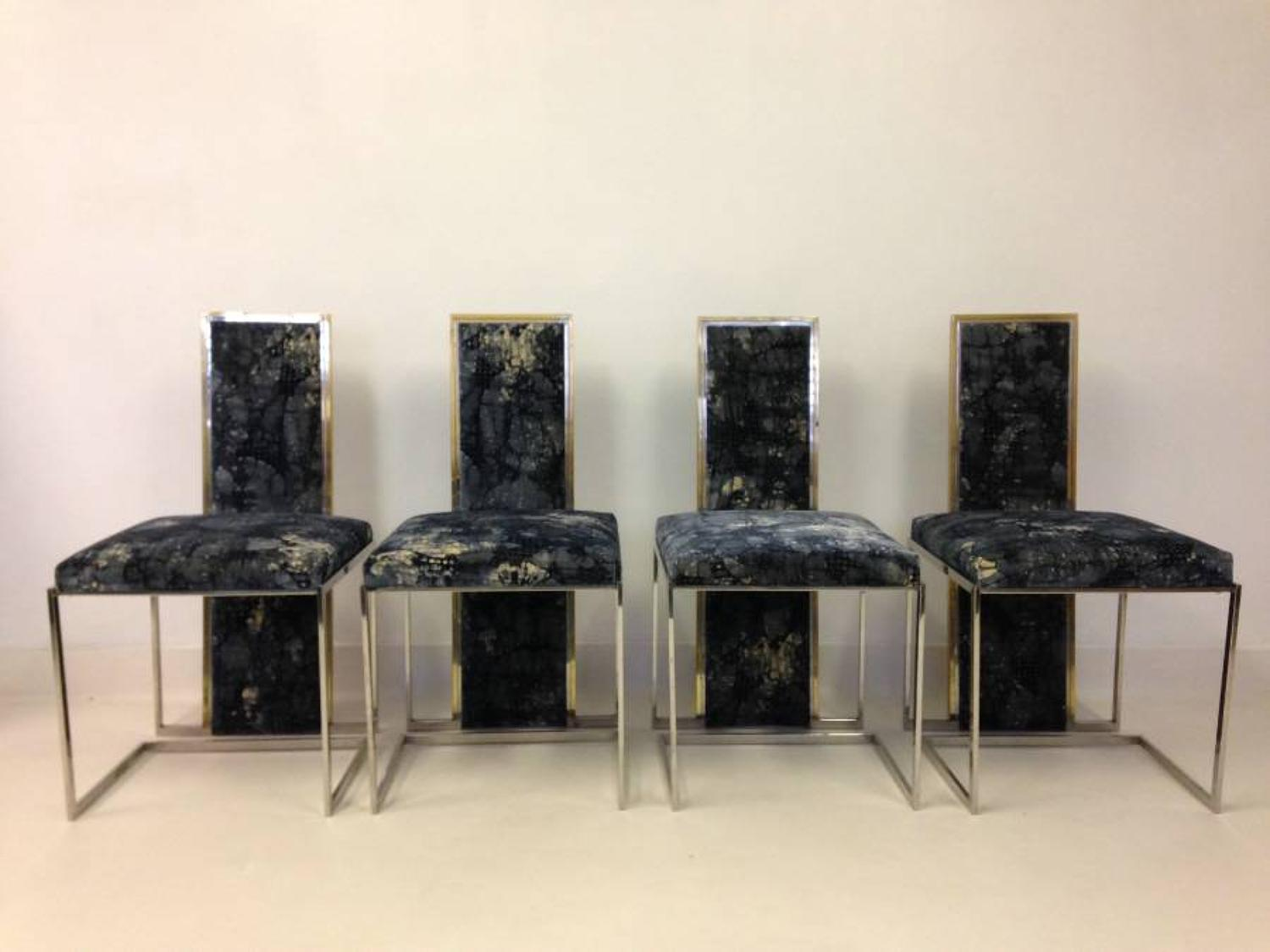 A set of four brass and chrome dining chairs