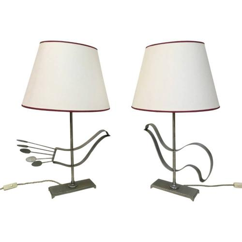 A pair of French steel abstract bird lamps