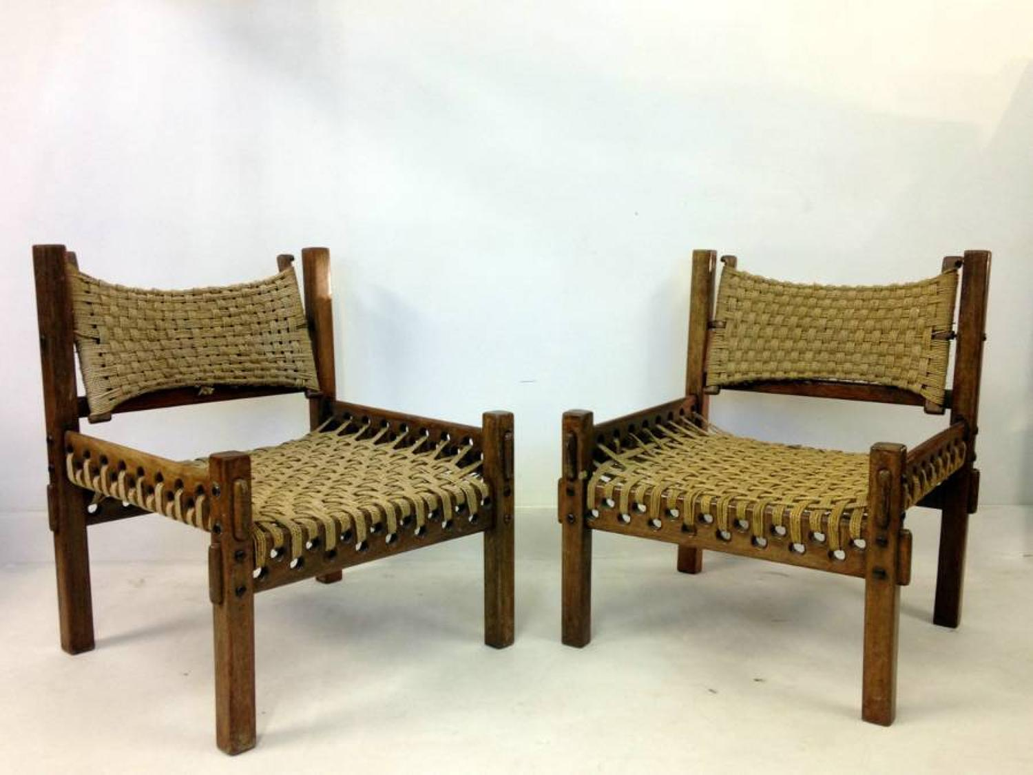 A pair of teak and rope chairs