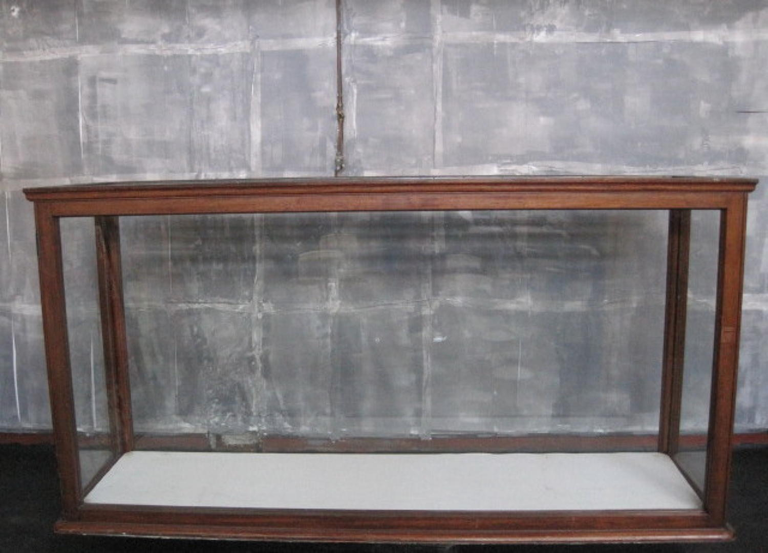 A pair of museum cabinets