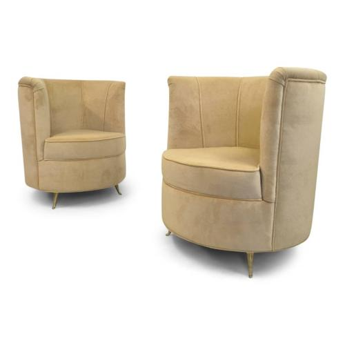 A pair of Italian cocktail chairs with brass legs