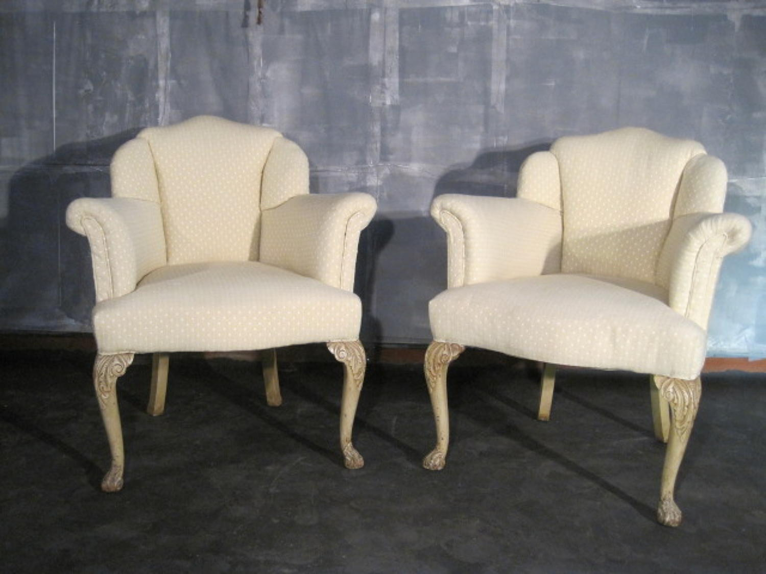 A pair of French style upholstered armchairs