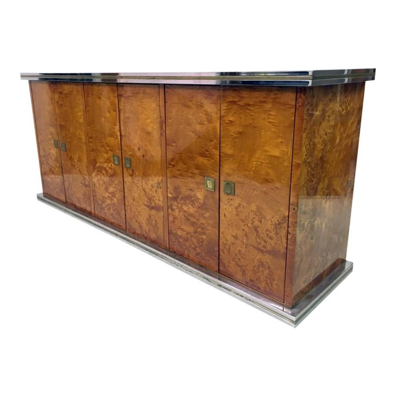 A burr walnut, chrome and brass sideboard