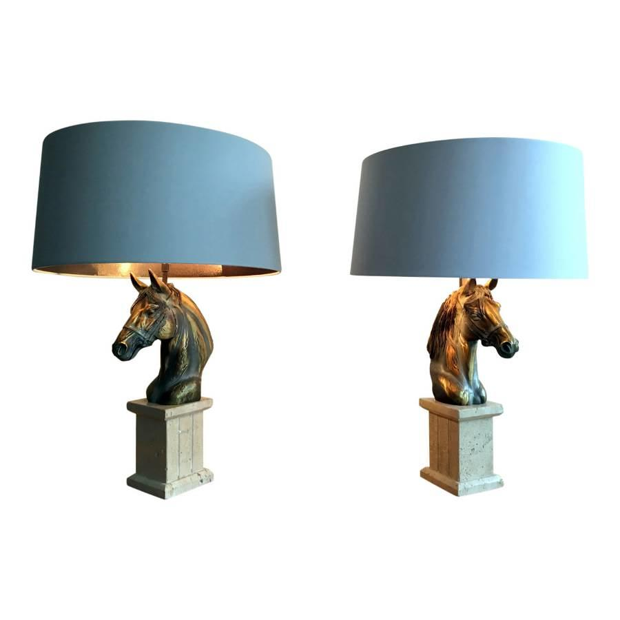 A pair of brass and travertine horse lamps
