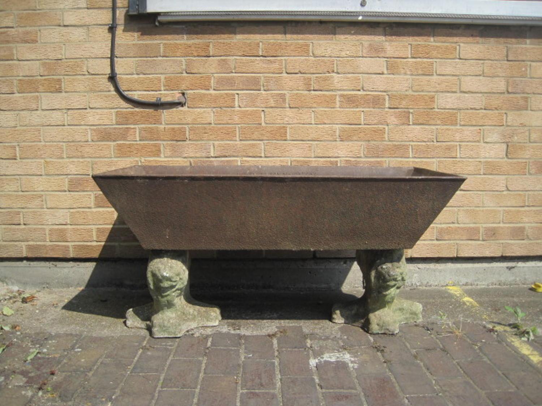 Cast iron trough on stone lions