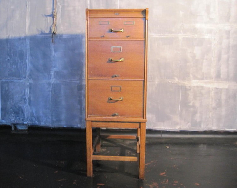 Oak filing cabinet on legs
