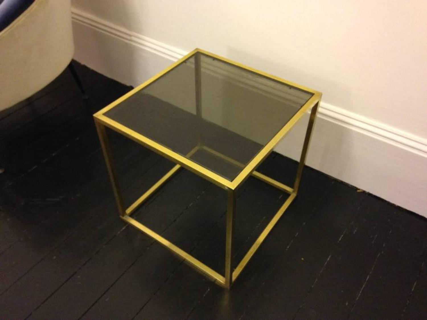 A brass cube side table