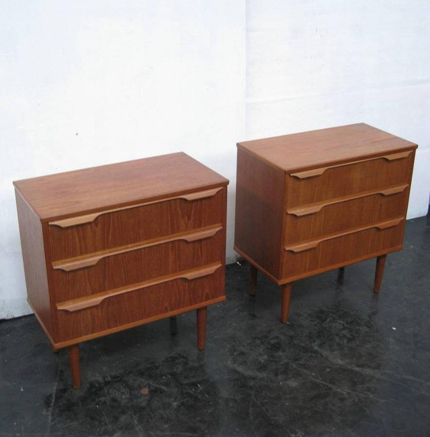 A pair of teak chest of drawers