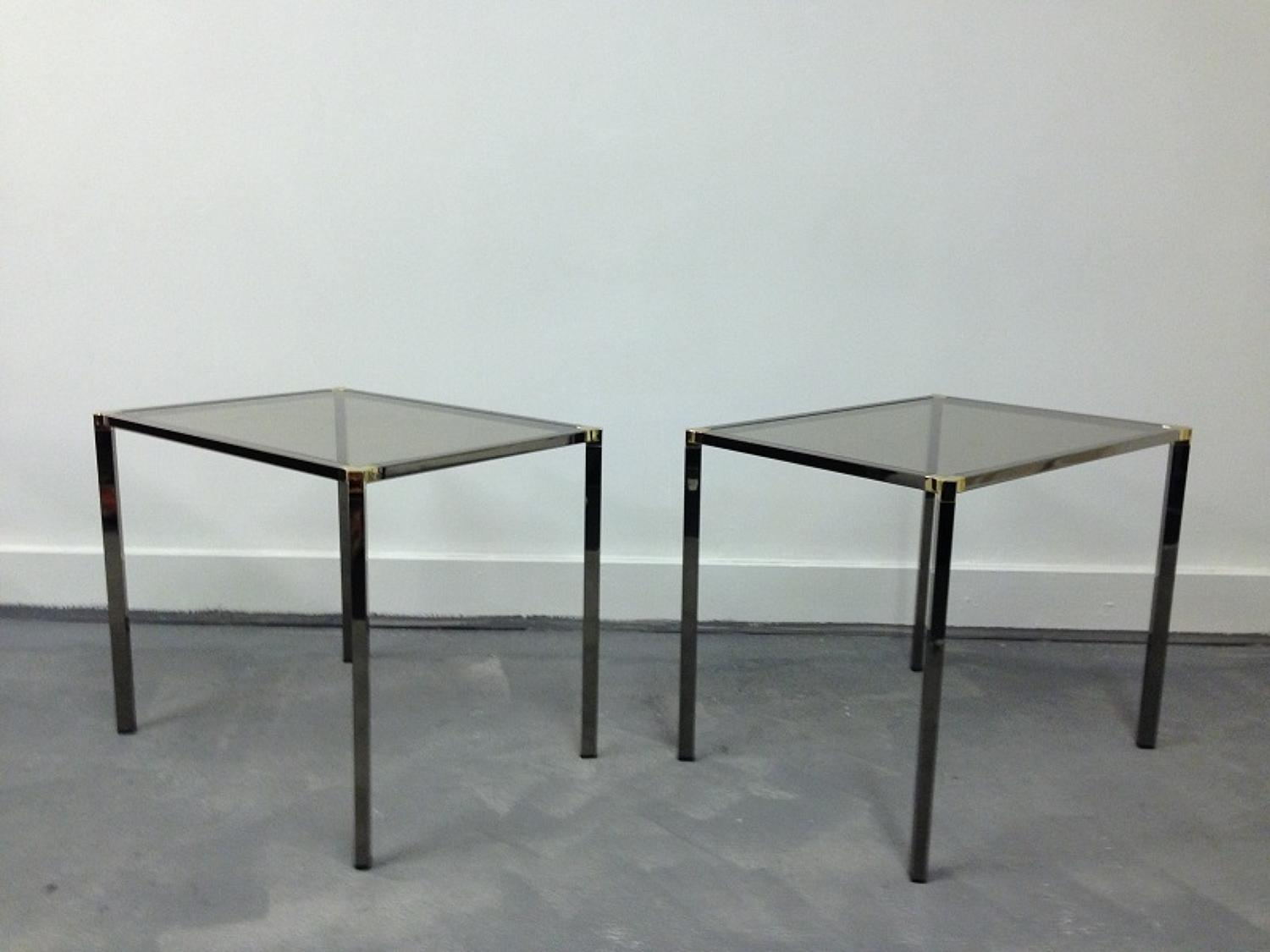 A pair of nickel and brass side tables