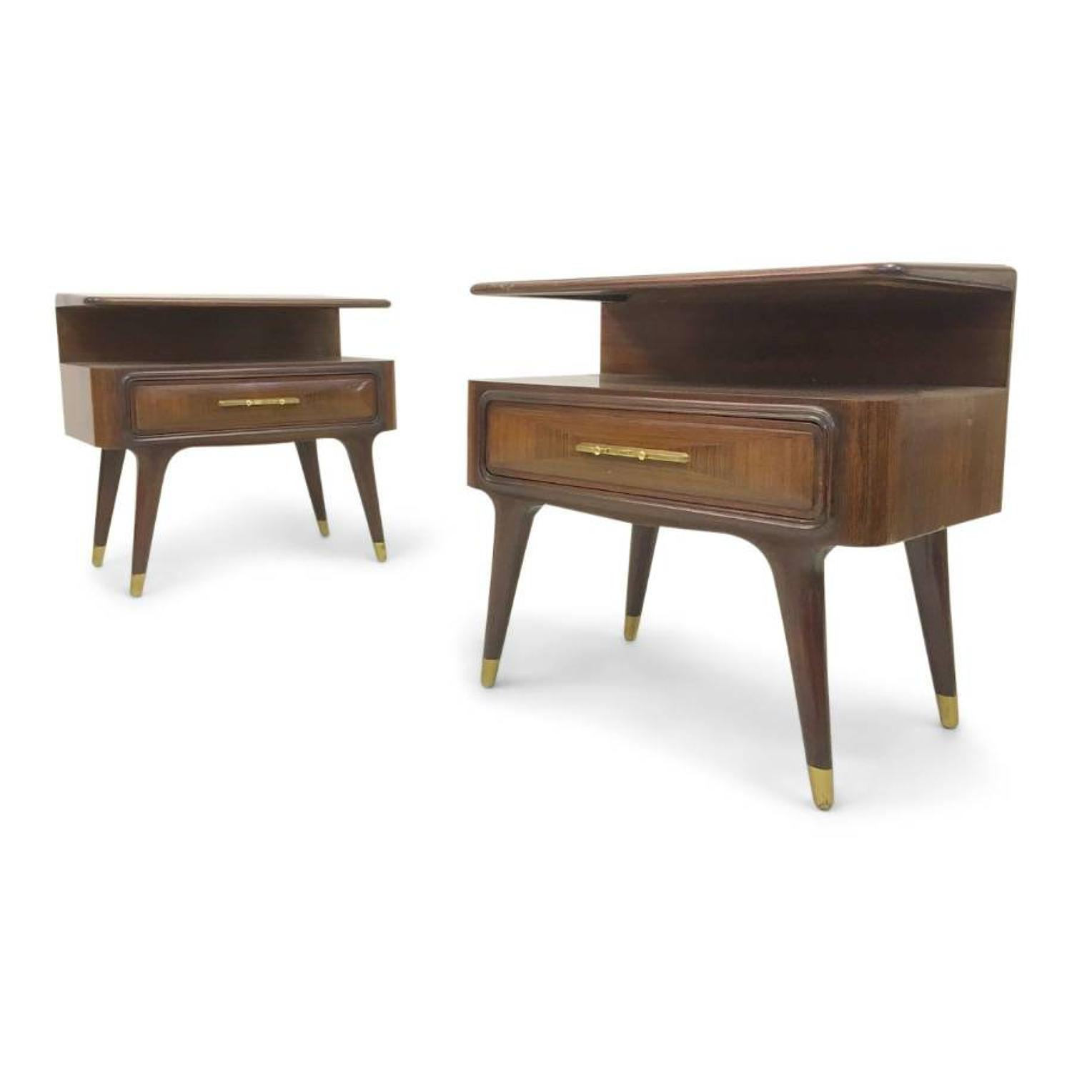 A pair of 1960s Italian rosewood bedside tables