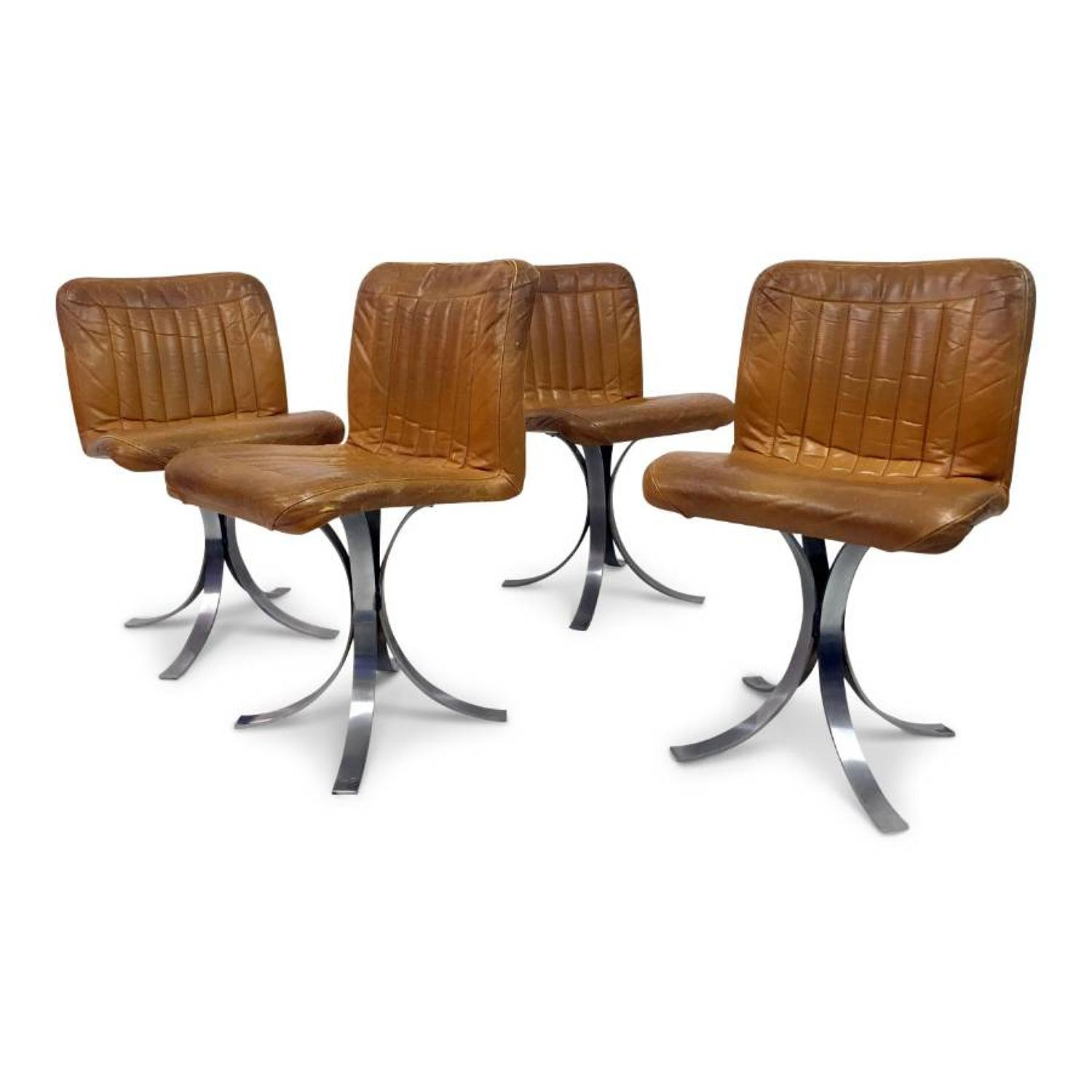 A set of four French leather and chrome dining chairs