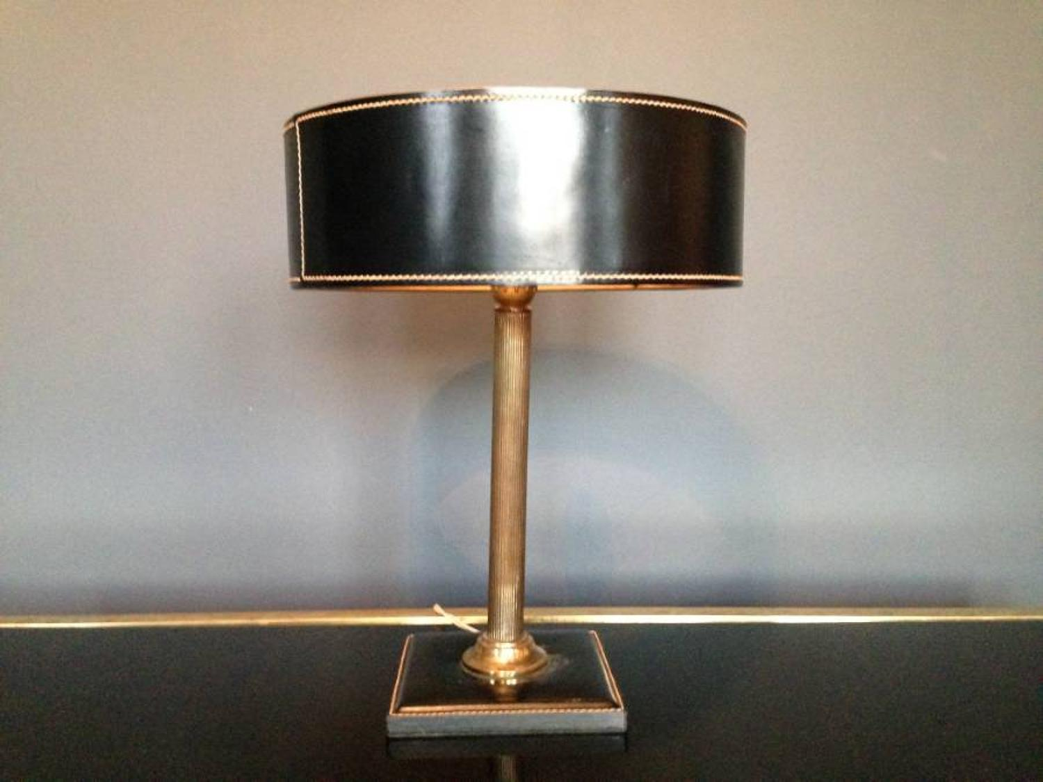 Stitched leather and brass lamp by Jacques Adnet