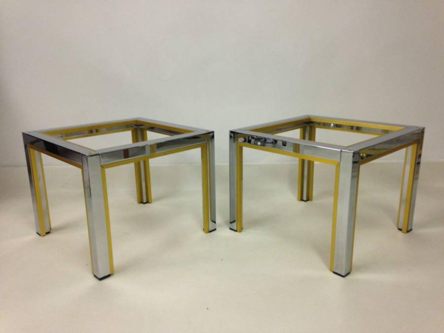 A pair of chrome and brass side tables