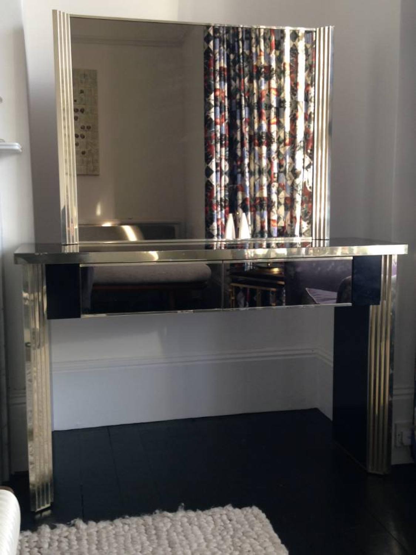 Italian gilt metal mirrored console and mirror