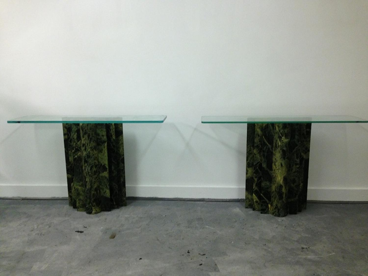 A pair of marble and glass console tables