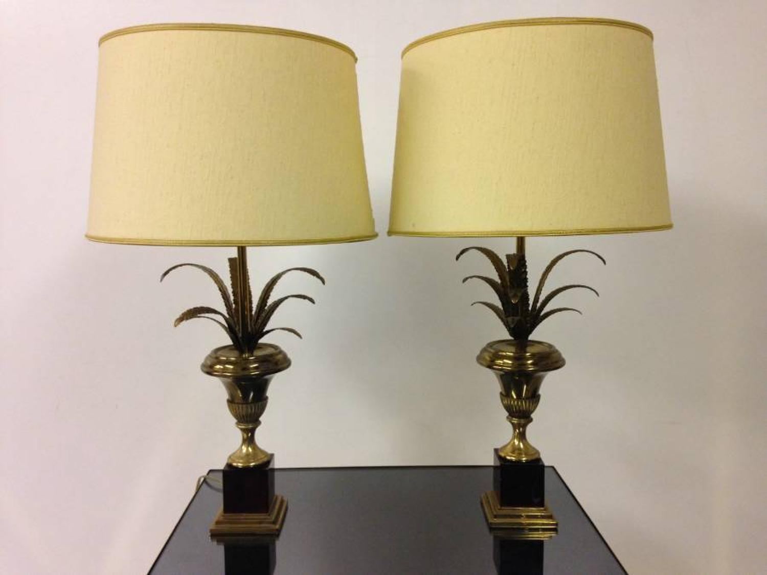 A pair of  brass and resin pineapple frond lamps