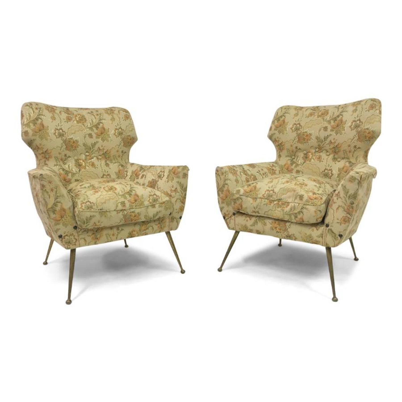 A pair of 1950s Italian armchairs on brass legs