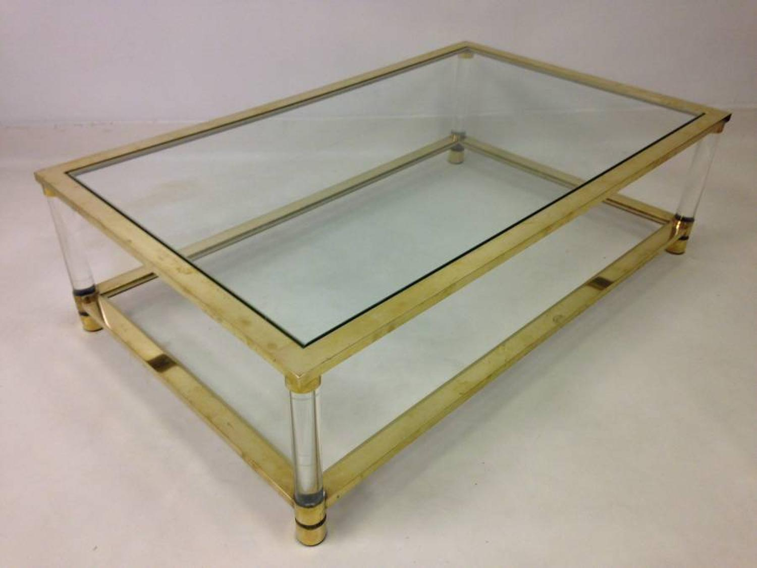 Two tier brass and lucite coffee table